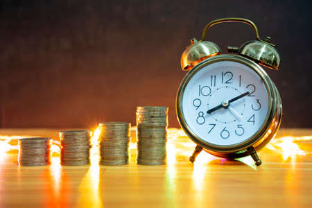 Time is money concept.Old coins and clock.Numismatics and collecting money.World currency.Silver,gold. saving money concept Imagens
