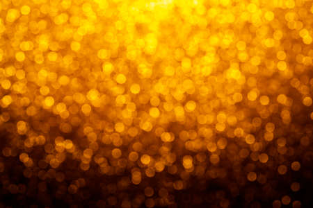 Gold abstract bokeh glitter vintage lights background. dark gold and black. defocused