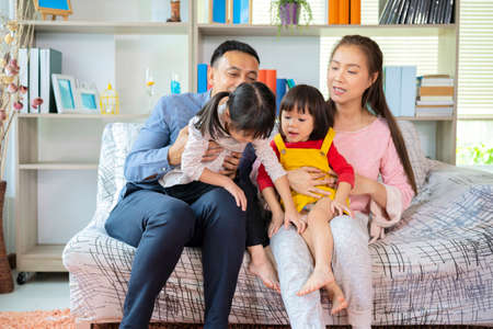 Happy Asian family playing together at sofa, home living room at home and weekend for family