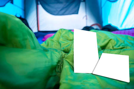 A blank postcard placed on a sleeping bag that was in the tent. The atmosphere inside the tent