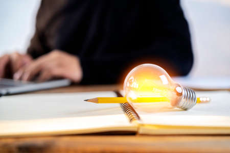 A light bulb is placed on book for reading, acquiring knowledge and finding new ideas. Education concept Standard-Bild