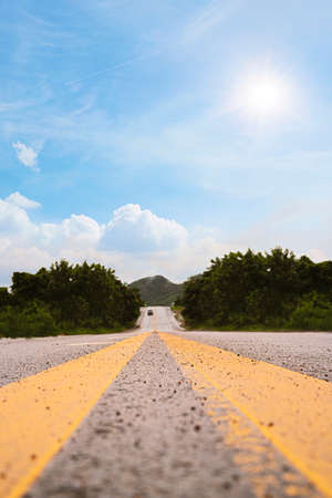 Color toned scenic highway, travel in Thailand on a beautiful hot sunny day with blue sky in summer