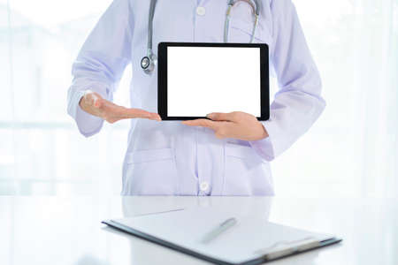 Doctor tablet computer medical with stethoscope and board. a paper board with a pen on the desk Standard-Bild