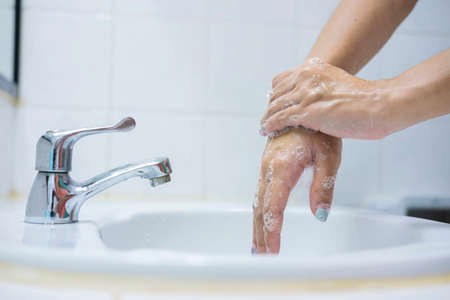 Wash your hands, soap your hands. Women's hands are washed with soap. Hand hygiene, skin care, disinfection. Soaping your hands with antibacterial soap