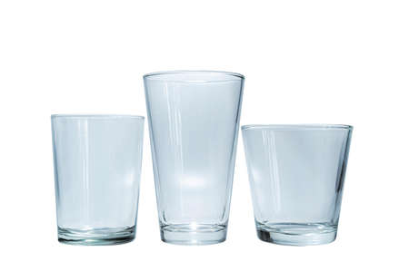 3 empty glasses of various sizes on a white background