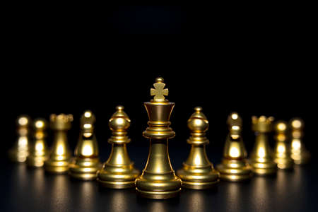 Golden chess pieces isolated on black background. Strategy ideas concept business futuristic graphic icon.