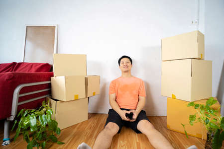 Happy at new home. Man having fun together. Moving house day and interior renovation concept 版權商用圖片