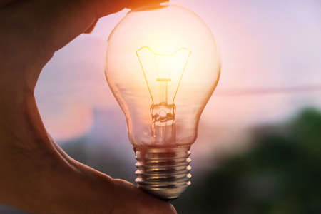 Hand holding light bulb. idea concept with innovation and inspiration for good idea. brainstorming creative idea.