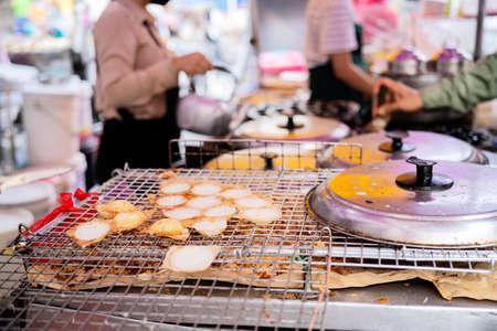 Kanom Krok is a very popular Thai dessert that can be found everywhere in Thailand. street food concept 版權商用圖片