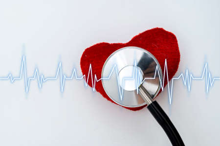 Heart disease concept. Medical stethoscope in the form of a heart rhythm on a white background. Copy space for text.