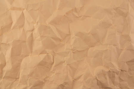 Old crumpled parchment folded paper texture brown color nobody for your background