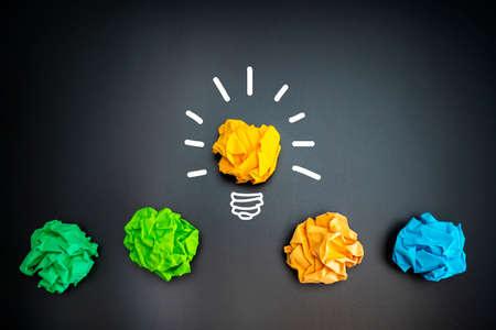 Paper Ball on Blackboard and lightbulb shape, Idea Concept