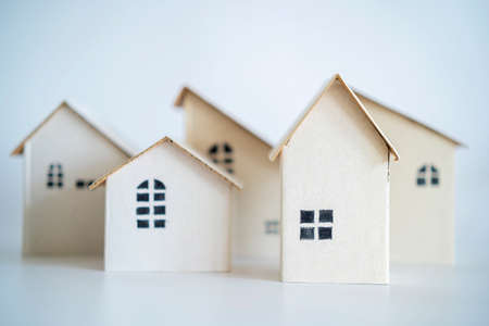 Paper house mockup on white background. Housing business concept. paper house model from group of house, selective focus, Planning to buy property. A symbol for construction