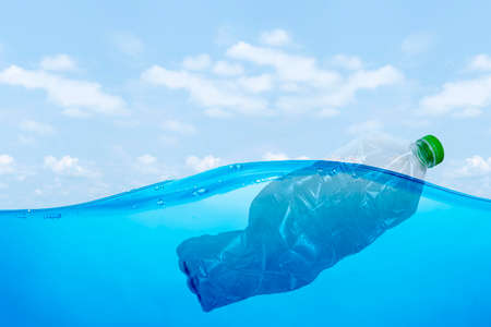 plastic waste at the ocean, a plastic bottle floating in the Mediterranean sea at the water surface, environmental problem with plastics pollution, copy space for text 版權商用圖片