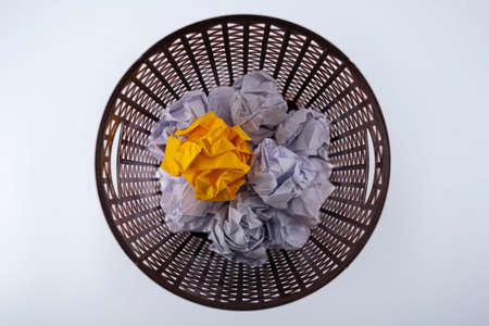 The yellow crumpled paper that was thrown into the trash As if you were throwing away a good idea, missing a good opportunity. 版權商用圖片