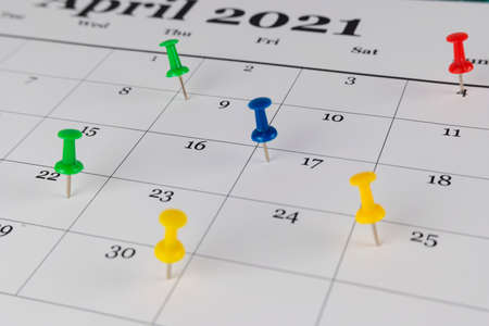 Thumbtack in calendar concept for busy, appointment and meeting reminder and marked the date the pushpin