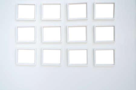White wooden photo frames mockup, eight set collection on white bricks wall, interior decor 版權商用圖片