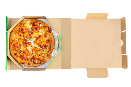 Pizza in a cardboard box against a white background. View from above. Pizza delivery. Pizza menu.