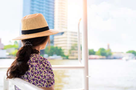 Women tourists take a boat tour of Bangkok in Thailand. Boat trips are important journeys.