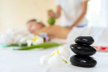 A pile of balancing smooth rocks, spa treatment concept. Spa background with having massage