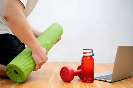 Fitness training, stretching exercises online men at home with laptop.