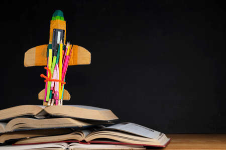 Startup Concept - Creative Rocket With Colorful Pencils And Books On Desk - Back To School