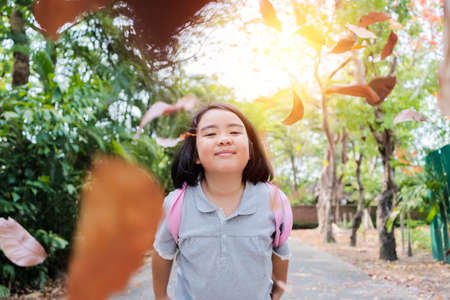 Funny little girl in the summer on nature little girl, has happy fun with cheerful smiling face. Carefree in the park 版權商用圖片