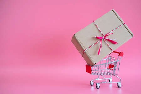 Online shopping concepts with small trolley and product package box. Ecommerce market.Transportation logistic.Business retail.Seller and buyer