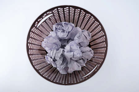 The crumpled paper that was thrown into the trash As if you were throwing away a good idea, missing a good opportunity.