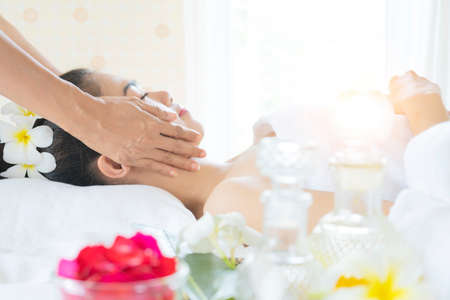 portrait of young beautiful woman in spa environment and healthy woman in spa salon. Traditional oriental massage therapy and beauty treatments.