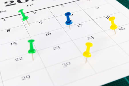 Thumbtack in calendar for busy, appointment and meeting reminder. Planning concept