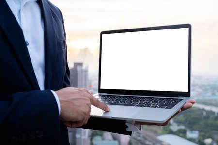 Young man working on his laptop with blank copy space screen for your advertising text message in office, Back view of business man hands busy using laptop at office