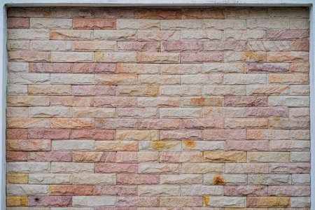 Wide beige brick wall background texture. Home and office design backdrop. Natural material abstract structure backdrop