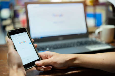 Bangkok. Thailand. 9 June 2020 : A woman is typing on Google search engine from a laptop. Google is the biggest Internet search engine in the world. Editorial