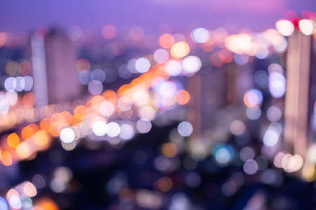 Blurred, Bokeh of cityscape building, sky train and twilight sky in Bangkok Stock Photo