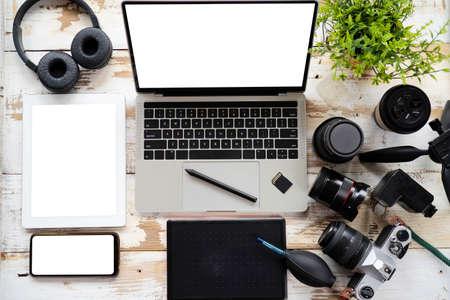 Camera photography design studio editing concept, desktop with photography equipment, camera, tripod,flash and computer