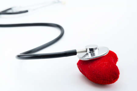 Red heart with stethoscope on white background, heart health, health insurance concept, world health day. Stock Photo
