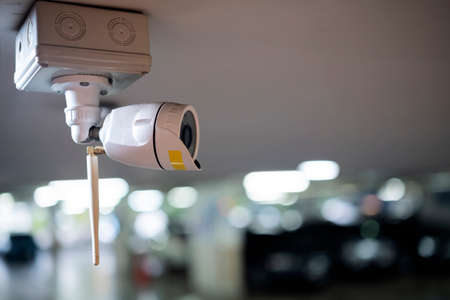 CCTV camera security in Parking garage In the mall for background. installed on the parking lot to protection security