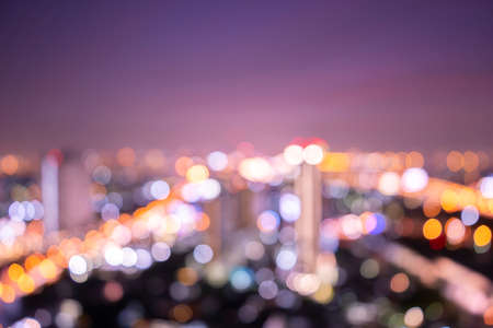 World environment day concept: Bokeh light and blur modern city skyline sunrise background. Bangkok, Thailand, Asia