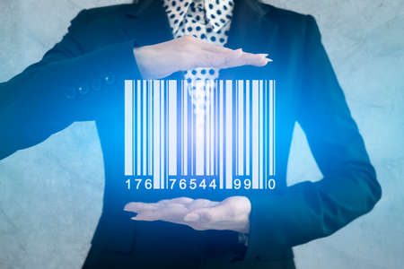 Businesswoman show barcode with glow light on hand, warehouse and logistics Stock Photo