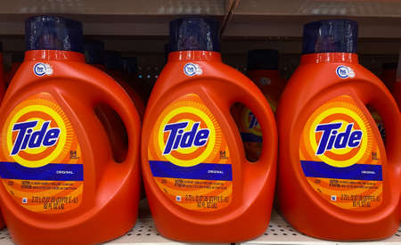 McKinney, TX / USA - August 18, 2020: Tide original scent liquid laundry detergent with 64 loads placed in the Walmart shelf Editorial