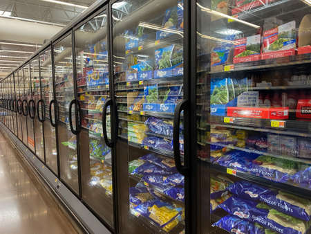 McKinney, TX / USA - August 18, 2020: multiple freezers lined up in the store