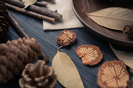 Some autumnal items such as deal apples leaves lie on wood table with vintage style - Image Stock Photo