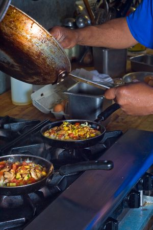 cooking with 3 frying pans on stovetop