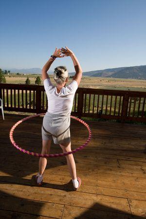 senior woman hula hooping