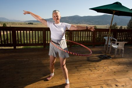 senior woman hula hooping
