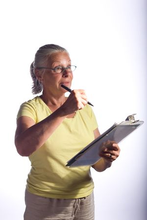 senior woman with clipboard