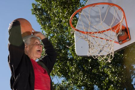 senior woman slam dunk