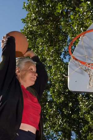 senior woman slam dunk photo