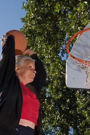 senior woman slam dunk